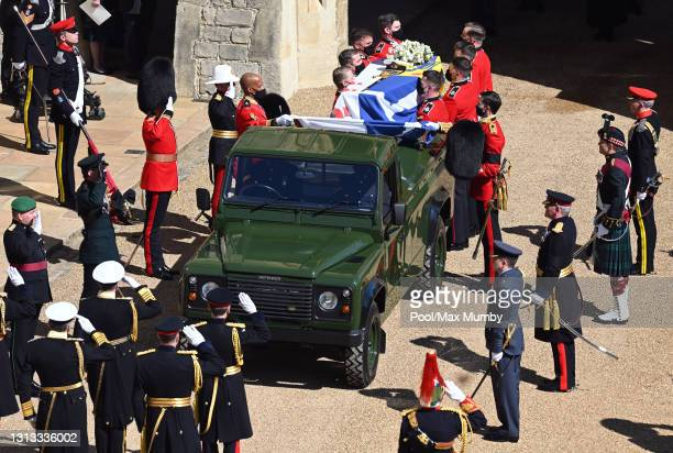 Bearer Party of Grenadier Guards place Prince Philip, Duke of Edinburgh's coffin onto a specially designed Land Rover Defender hearse during his...