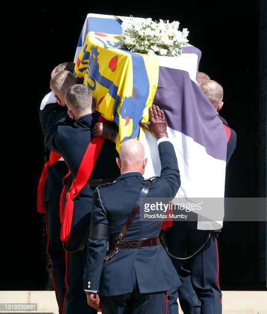 Bearer Party of Royal Marines carry Prince Philip, Duke of Edinburgh's coffin into St. George's Chapel, Windsor Castle for his funeral service on...