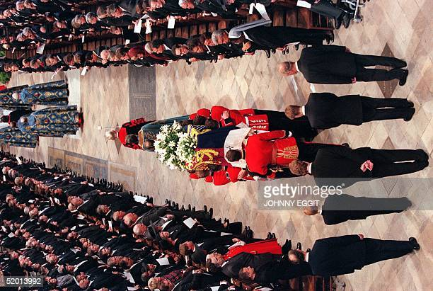 A bearer party of Welsh Guards carry the coffin of Diana Princess of Wales into the Westminster Abbey in London 06 September followed by Diana's...