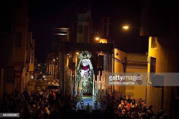Bearers of the Brotherhood of the Virgen de la Macarena take part in the Procession of the Meeting between Mary and Jesus during the Holy Week in...