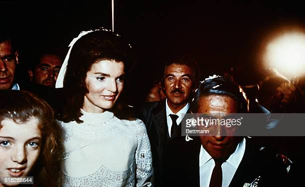 Bearing traces of confetti Mr and Mrs Aristotle Onassis are shown at their wedding here on Onassis' private island
