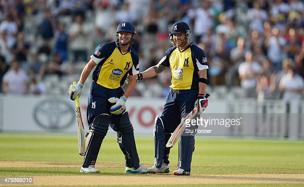 Bears batsman Brendon McCullum shares a joke with William Porterfield after reaching his 150 during the NatWest T20 Blast match between Birmingham...