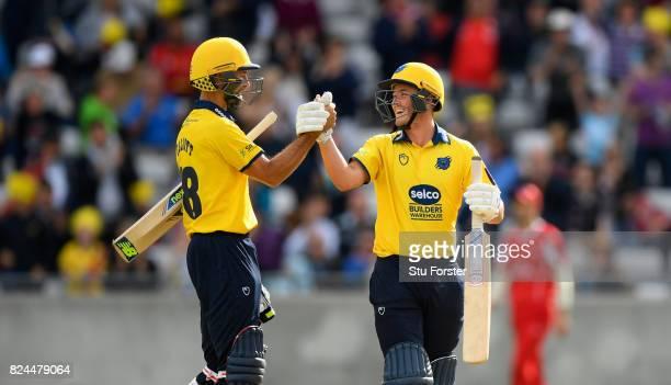 Bears batsman Grant Elliott and Aaron Thomason celebrate the winning runs scored by Elliott during the Natwest T20 Blast match between Birmingham...
