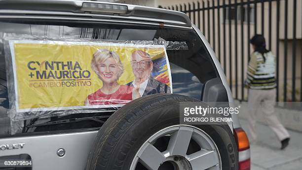 A SUV bears electoral propaganda of presidential candidate Cynthia Viteri and her running mate Mauricio Pozo in Quito on January 3 2017 as...