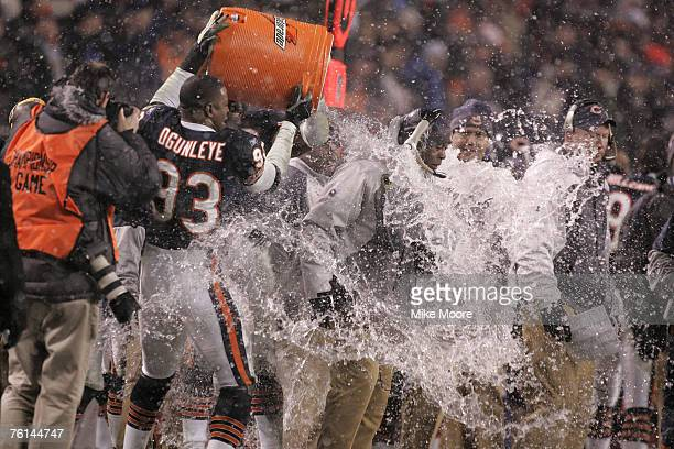 Bears head coach Lovie Smith gets his victory dousing during the Bears 39 to 14 win over the Saints in the NFC Championship game at Soldier Field in...