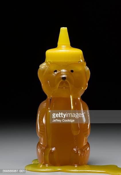 Bear-shaped honey bottle dripping