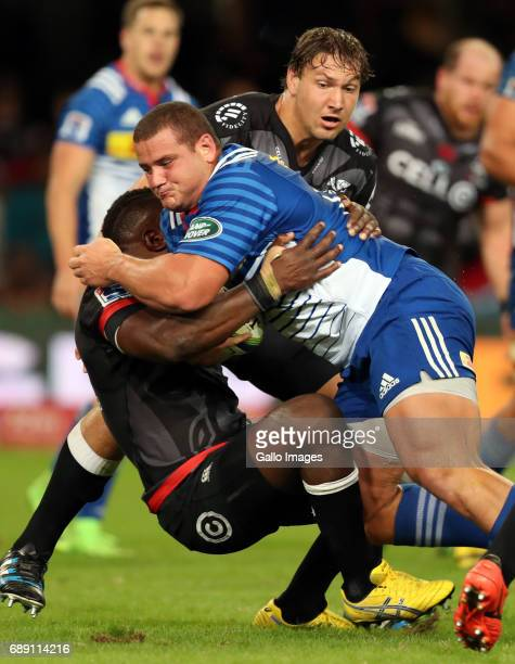 Beast Mtawarira of the Cell C Sharks has to tackle Wilco Louw of the DHL Stormers during the Super Rugby match between Cell C Sharks and DHL Stormers...