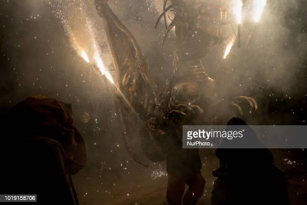 A beast spits fire during the celebration of Sant Roc Festival in Barcelona on 18 August 2018 Correfocs an old Catalan tradition where people dressed...