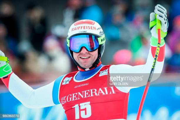 Beat Feuz from Switzerland reacts after competing in the Men's SuperG event at the FIS Alpine Skiing World Cup on March 11 2018 in Kvitfjell Norway /...