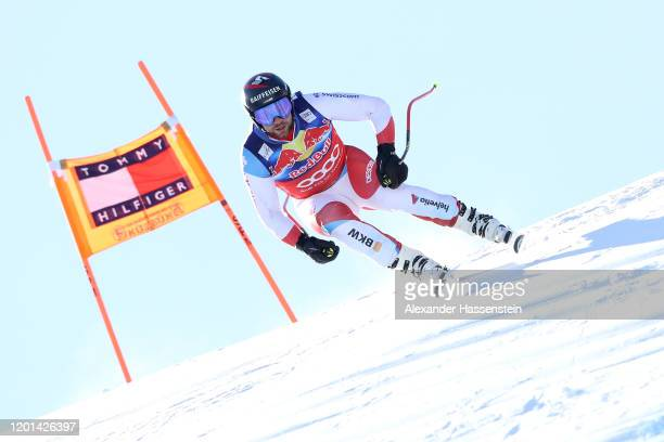 Beat Feuz of Switzerlabd competes during a training session for the Hahnenkamm Rennen Audi FIS alpine ski world cup men's downhill at Streif on...