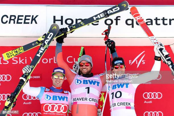 Beat Feuz of Switzerland Aksel Lund Svindal of Norway and Thomas Dressen of Germany celebrate on the medals podium after the Men's Downhill during...