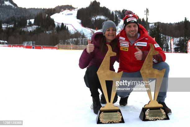 """Beat Feuz of Switzerland and his wife Katrin Triendl pose with his two """"Golden Chamois"""" winners trophy for winning both Audi FIS Alpine Ski World Cup..."""