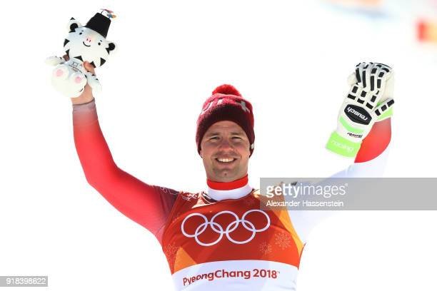 Beat Feuz of Switzerland celebrates winning the bronze medal on the podium during the Men's Downhill on day six of the PyeongChang 2018 Winter...