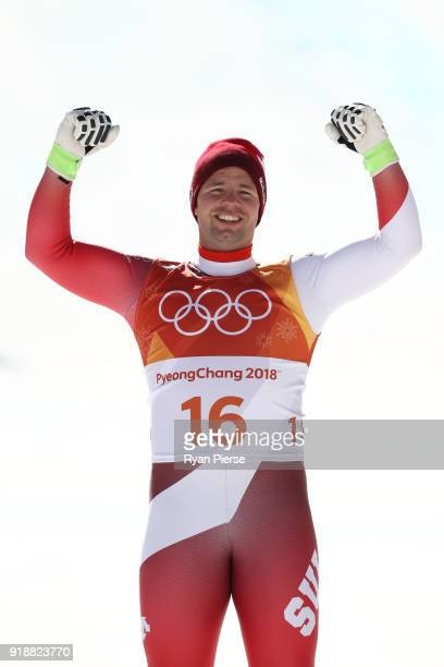 Beat Feuz of Switzerland celebrates winning the silver medal on the podium following the Men's SuperG on day seven of the PyeongChang 2018 Winter...