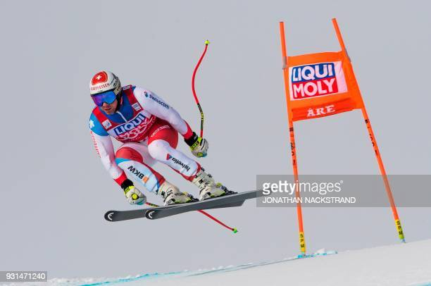 Beat Feuz of Switzerland races during the Men's Downhill training round ahead of the FIS World Cup final event in Aare Sweden on March 13 2018 / AFP...