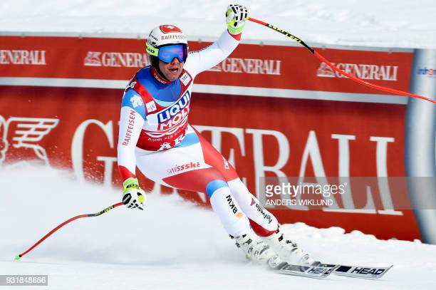 Beat Feuz of Switzerland reacts after his race in the Men's Downhill of the FIS World Cup final event in Aare Sweden on March 14 2018 / AFP PHOTO /...