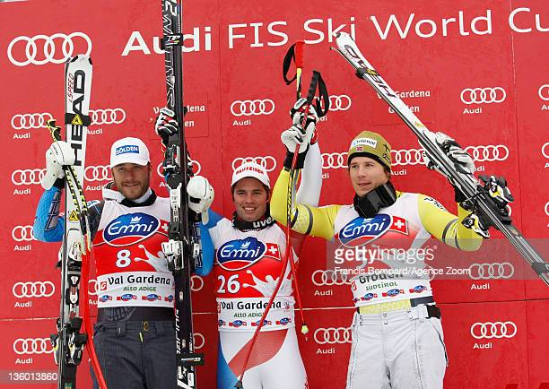Beat Feuz of Switzerland takes 1st place, Bode Miller of the USA takes 2nd place, Kjetil Jansrud of Norway takes 3rd place during the Audi FIS Alpine...