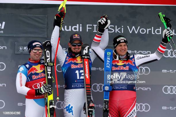 Beat Feuz of Switzerland takes 2nd place Dominik Paris of Italy takes 1st place Otmar Striedinger of Austria takes 3rd place during the Audi FIS...