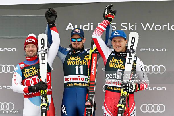 Beat Feuz of Switzerland takes 2nd place Dominik Paris of Italy takes 1st place Matthias Mayer of Austria takes 3rd place during the Audi FIS Alpine...