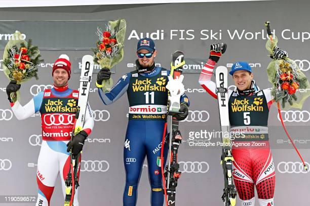 Beat Feuz of Switzerland takes 2nd place, Dominik Paris of Italy takes 1st place, Matthias Mayer of Austria takes 3rd place during the Audi FIS...