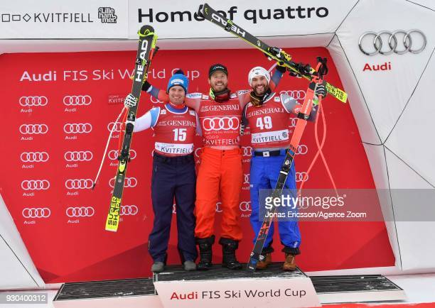 Beat Feuz of Switzerland takes 2nd place, Kjetil Jansrud of Norway takes 1st place, Brice Roger of France takes 3rd place during the Audi FIS Alpine...