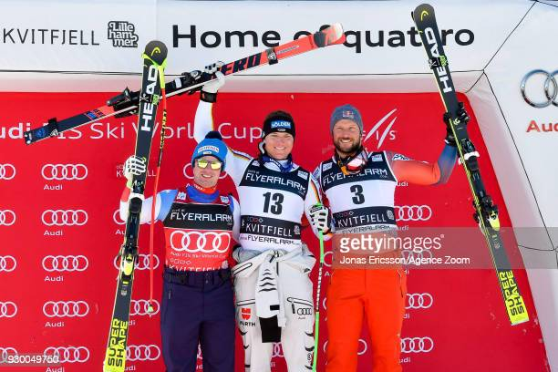 Beat Feuz of Switzerland takes 2nd place Thomas Dressen of Germany takes 1st place Aksel Lund Svindal of Norway takes 3rd place during the Audi FIS...