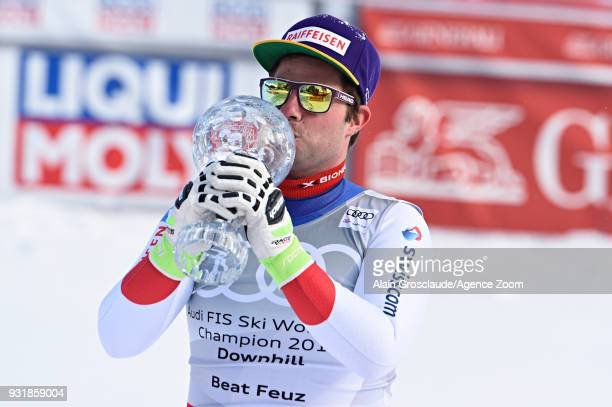 Beat Feuz of Switzerland wins the globe in the men downhill standing during the Audi FIS Alpine Ski World Cup Finals Men's and Women's Downhill on...