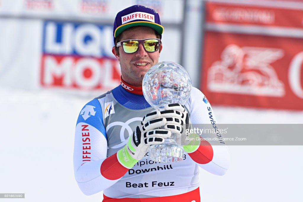 Beat Feuz of Switzerland wins the globe in the men downhill standing during the Audi FIS Alpine Ski World Cup Finals Men's and Women's Downhill on March 14, 2018 in Are, Sweden.