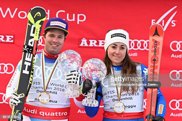 Beat Feuz of Switzerland wins the globe in the men downhill standing Sofia Goggia of Italy wins the globe in the women downhill standing during the...