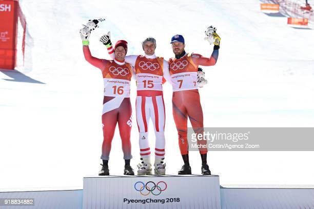 Beat Feuz of Switzerland wins the silver medal Matthias Mayer of Austria wins the gold medal Kjetil Jansrud of Norway wins the bronze medal during...