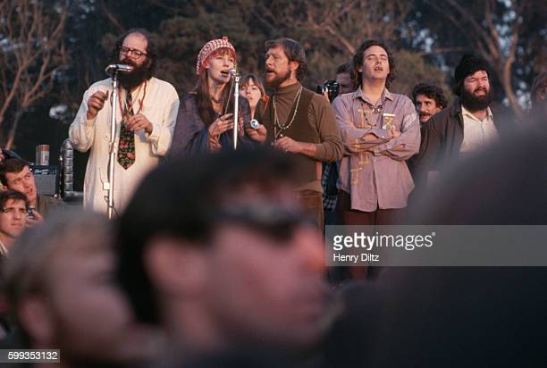 Beat poet Allen Ginsberg addresses the Human BeIn with hippie singers backing him up Golden Gate Park San Francisco California USA