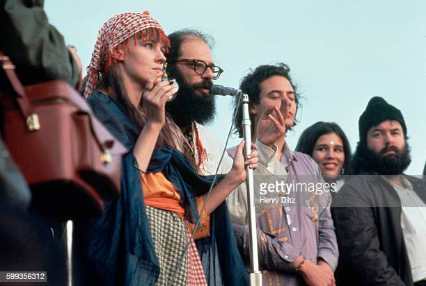 Beat poet and political activist Allen Ginsberg speaks to the crowd at a human bein at San Francisco's Golden Gate Park