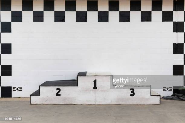 a beat up award podium at a race track - ceremony stock pictures, royalty-free photos & images