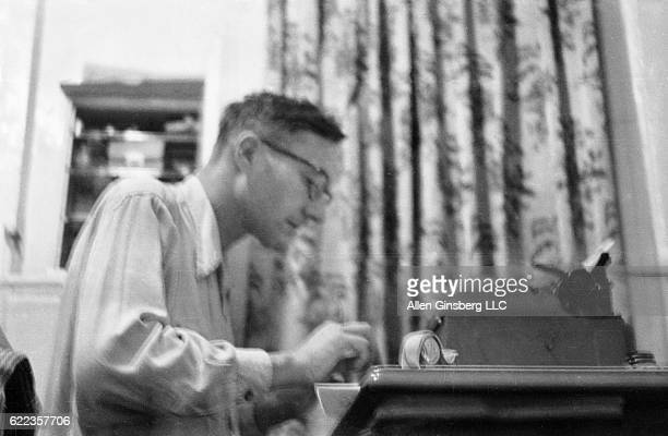 Beat writer William S Burroughs works on the typescript of Yage Letters from his apartment in the Lower East Side