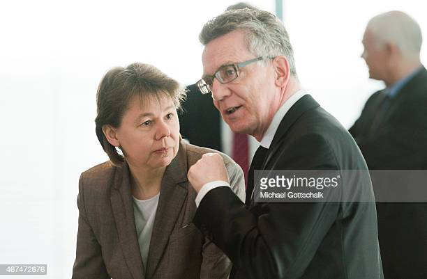 Beate Baumann head of German Chancellor Angela Merkel's office and German Interior Minister Thomas de Maiziere attend the weekly cabinet meeting at...