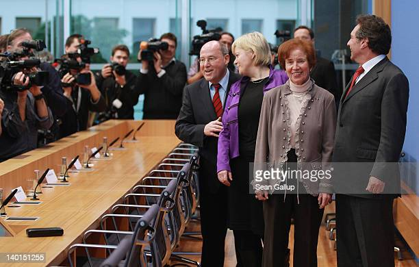 Beate Klarsfeld arrives with lead members of Die Linke German leftwing political party Gesine Loetzsch Klaus Ernst and Gregor Gysi at a press...