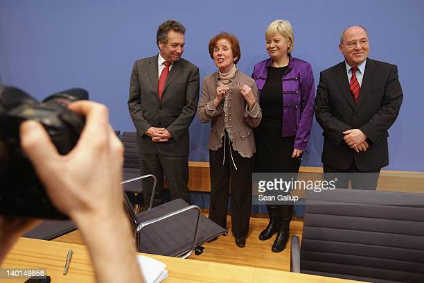 Beate Klarsfeld brings attention to a French award she is wearing while she poses with lead members of Die Linke German leftwing political party...