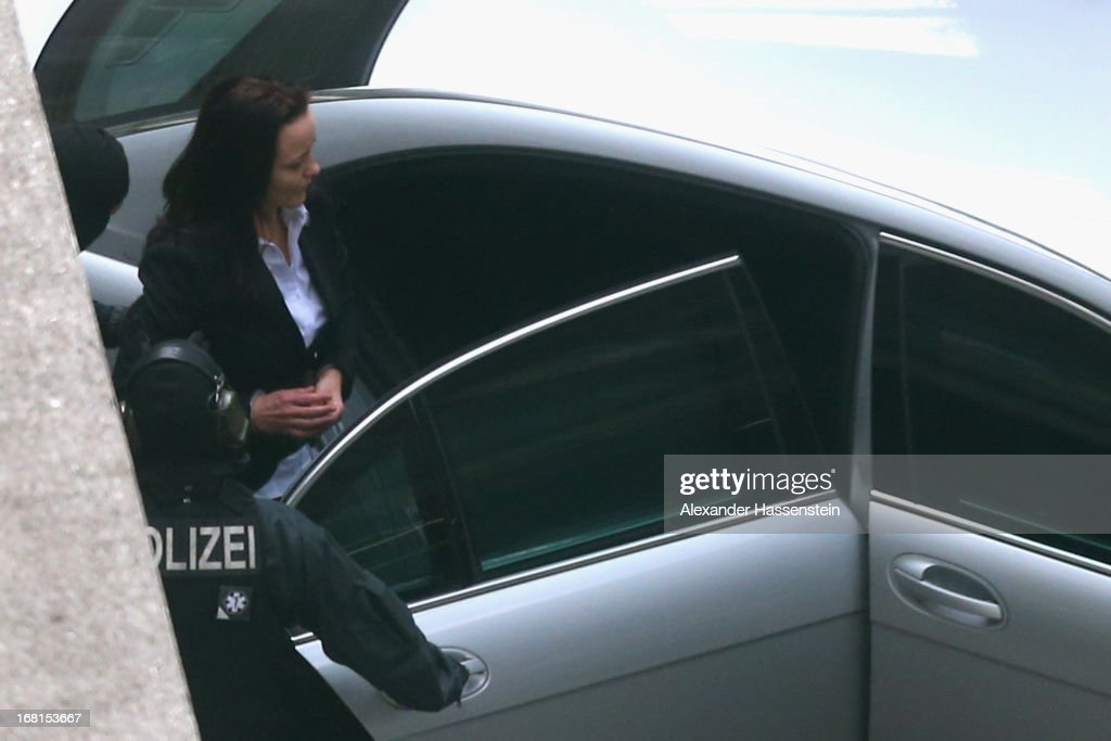 Beate Zschaepe leaves the Oberlandesgericht Muenchen building handcuffed and manacled after the first day of her and four of her supporters' trial in the NSU neo-Nazi murder case at the Oberlandesgericht Muenchen state court on May 6, 2013 in Munich, Germany. Zschaepe is on trial for her role in assisting Uwe Boehnhardt and Uwe Mundlos in the murder of nine immigrants and one policewoman across Germany between 2000 and 2007. The trio lived together for years undetected by police and called themselves the National Socialist Underground, or NSU. The case only came to light after Mundlos and Boehnhardt committed suicide after the two were cornered by police following a bank robbery in 2011.