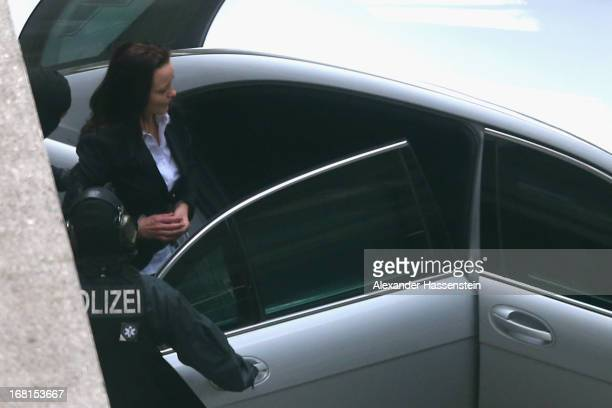 Beate Zschaepe leaves the Oberlandesgericht Muenchen building handcuffed and manacled after the first day of her and four of her supporters' trial in...