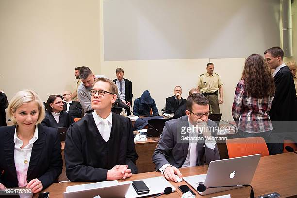 Beate Zschaepe main defendant in the NSU neoNazi murder case stands next to her lawyer Mathias Grasel while her other lawyers Anja Sturm Wolfgang...