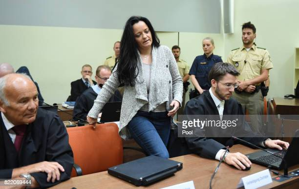 Beate Zschaepe the main defendant in the marathon NSU neoNazi murder trial sits inbetween her lawyers Hermann Borchert and Mathias Grasel in court on...