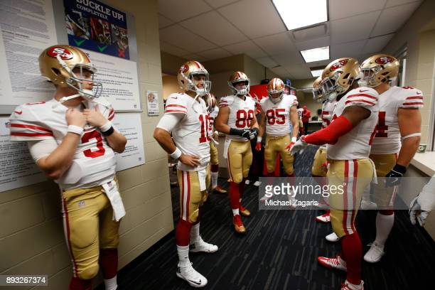 J Beathard and Jimmy Garoppolo of the San Francisco 49ers stand in the locker room prior to the game against the Houston Texans at NRG Stadium on...