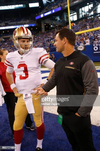 J Beathard and Quarterbacks Coach Rich Scangarello of the San Francisco 49ers talk on the field prior to the game against the Indianapolis Colts at...