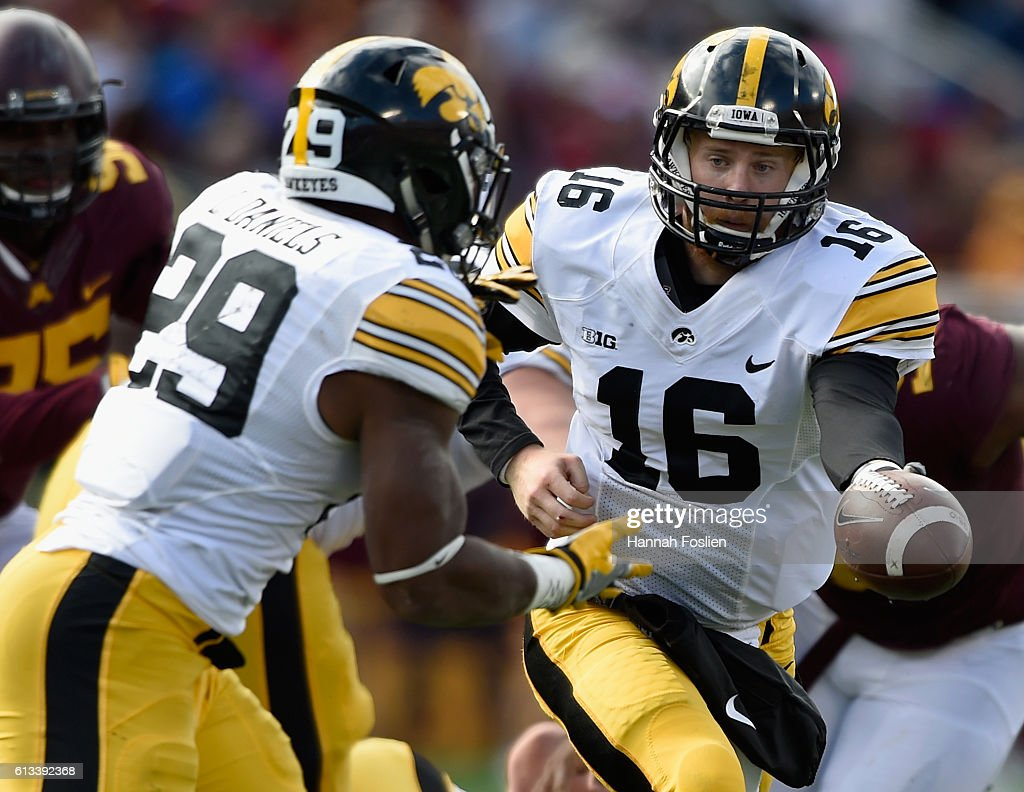 C.J. Beathard #16 of Iowa hands the ball to teammate LeShun Daniels Jr. #29 against Minnesota during the third quarter of the game on October 8, 2016 at TCF Bank Stadium in Minneapolis, Minnesota. Iowa defeated Minnesota 14-7.
