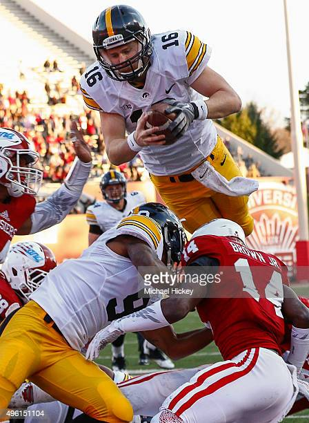 Beathard of the Iowa Hawkeyes dives into the end zone to score a touchdown against the Indiana Hoosiers at Memorial Stadium on November 7, 2015 in...