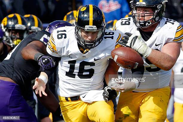 J Beathard of the Iowa Hawkeyes looks at a loose ball after Deonte Gibson of the Northwestern Wildcats caused a fumble during the second quarter at...