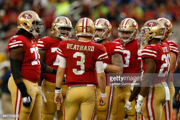 J Beathard of the San Francisco 49ers calls a play in the huddle against the Seattle Seahawks at Levi's Stadium on November 26 2017 in Santa Clara...