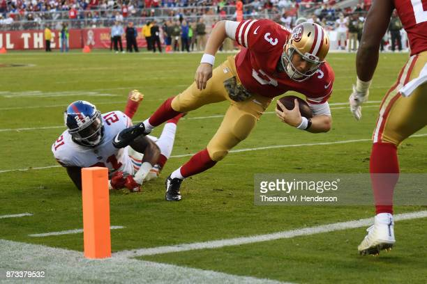 J Beathard of the San Francisco 49ers dives into the end zone for an 11yard touchdown against the New York Giants during their NFL game at Levi's...