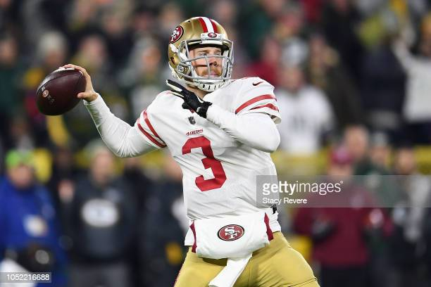 J Beathard of the San Francisco 49ers drops back to pass during the first quarter against the Green Bay Packers at Lambeau Field on October 15 2018...