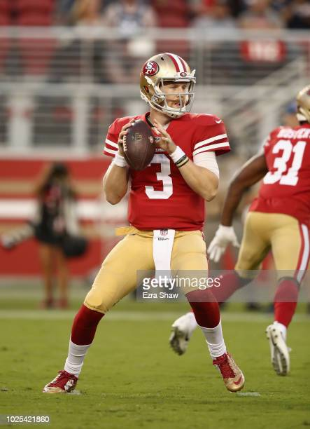 J Beathard of the San Francisco 49ers drops back to pass during their preseason game against the Los Angeles Chargers at Levi's Stadium on August 30...